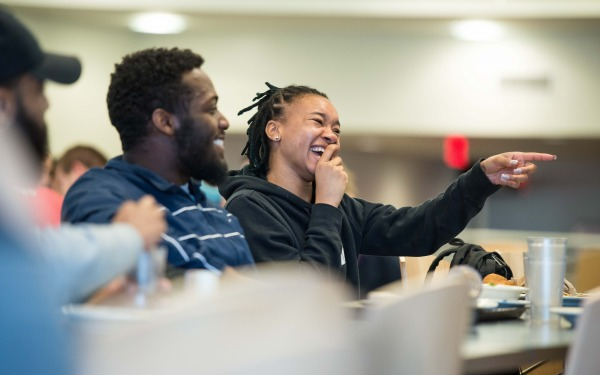 Students laughing in Holmes Dining