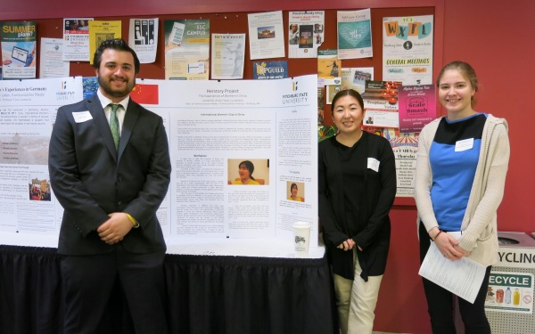 COMM students presenting at research conference