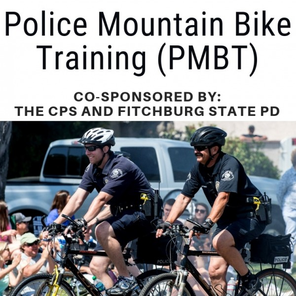 Police officers riding mountain bikes