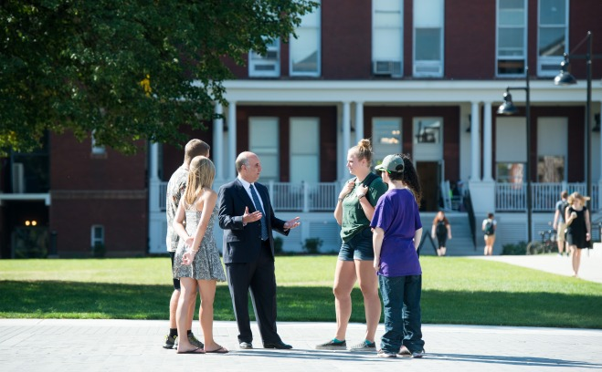 President Lapidus speaks with students on the quad