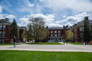 Students walking across quad on a sunny afternoon