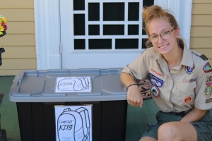 Erin Donelan poses with one of the comfort kits she created for her Eagle Scout project