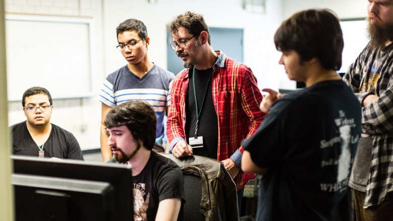 Professor Jeff Warmouth with Game Design students