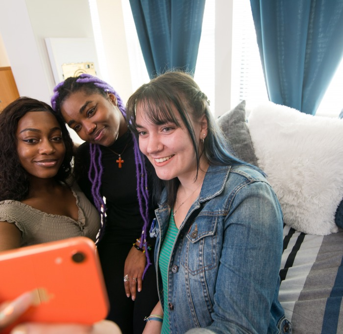 Fitchburg State students smiling as they take a selfie