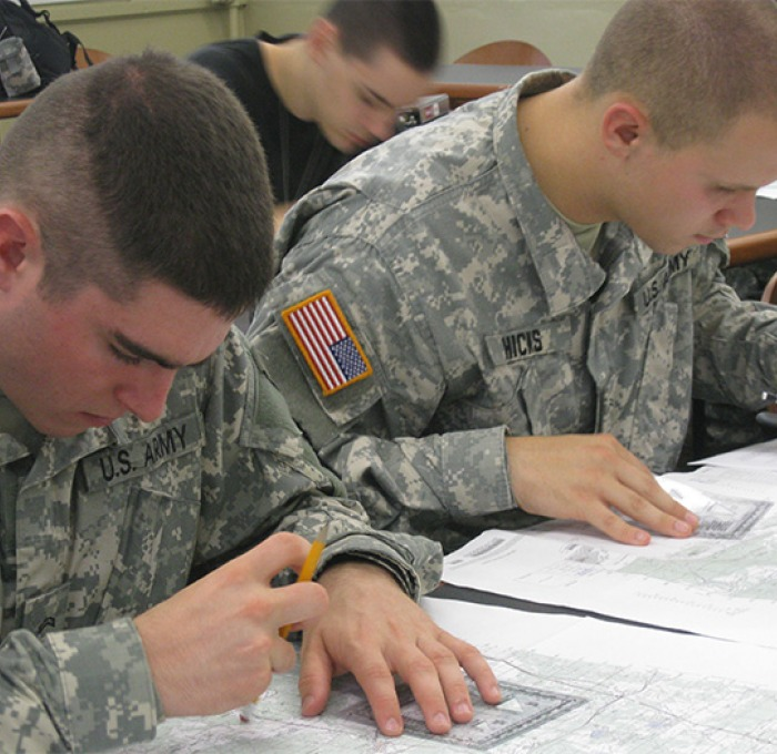ROTC students working with maps