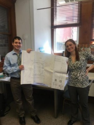 Ed Zink and Elizabeth Wood holding up plans