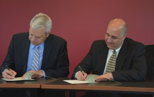 Superintendent of Schools Andre Ravenelle and President Lapidus sign the updated Honors Compact.