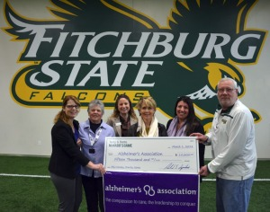 Shown here presenting the funds are, from left, Karen McNabb Noon, Bette McNabb, Fitchburg State…