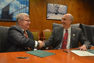 MPTC Executive Director Robert Ferullo and President Lapidus shaking hands