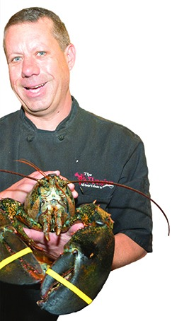 Jason Kimball holding a lobster