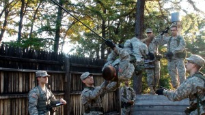 ROTC students doing a rope climbing exercise